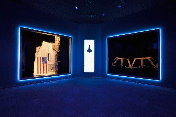 "A section of the fuselage recovered from space shuttle Challenger, left, and the flight deck windows recovered from space shuttle Columbia are part of a new, permanent memorial, ""Forever Remembered,"" opening June 27 in the Space Shuttle Atlantis exhibit at the Kennedy Space Center Visitor Complex in Florida. Credits: NASA/Kim Shiflett"